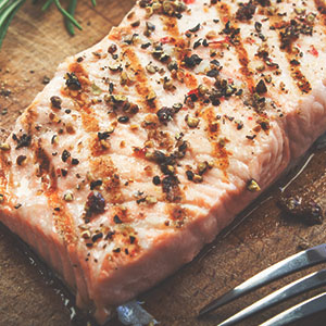 Grilled Salmon Steaks with Dill Butter Sauce and Fresh Rocket